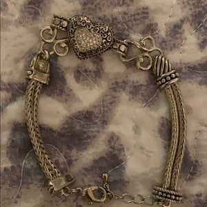 Silver heart bracelet with stones .